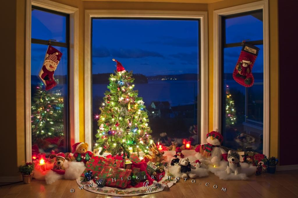 photo of a christmas scene with a decorated tree and stockings hanging in the window