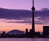 Enjoy a Toronto Vacation while on Ontario Holidays and experience a sunset with Torontos Skyline in the foreground