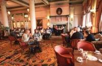 Having afternoon tea in the tea room of the Empress Hotel of Victoria on Vancouver Island, British Columbia, Canada.