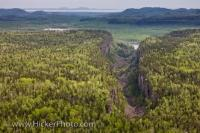 From an aerial perspective, Ouimet Canyon appears like a giant tear in the forested landscape of Ontario, Canada. Situated in the Ouimet Canyon provincial park, the canyon was named after a railway station which was once located nearby.