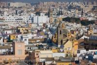 A glorious aerial view over the city of Sevilla, specifically the Santa Cruz District from La Giralda, the famous bell tower of the Seville Cathedral. Large numbers of churches and historic buildings form the hub of the Santa Cruz district.