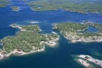 An aerial photo of the many islands situated in one of the largest bays of the Great Lakes, Georgian Bay in Lake Huron, Ontario, Canada.