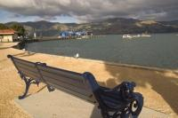 Park bench looking towards the ocean surrounded by beautiful Banks Peninsula on the South island of New Zealand.