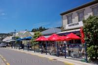 Street cafes fill the streets of the town of Akaroa on the South Island of New Zealand.