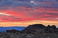An array of colour lights up the clouds above the Alabama Hills Recreation Area during sunrise.