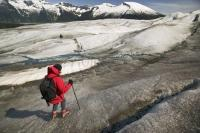 Real Alaska adventure is a tourist enjoyng glacier walking on the Taku Glacier
