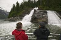 A waterfall is seen by tourist during Alaskan Cruising in the Tongass National Forest to the Sawyer Glacier in Tracy Arm Fjord.