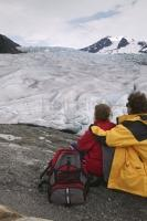 A young couple enjoying the amazing view over Mendenhall Glacier near Juneau, a often visited alaskan glacier.