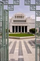 The entranceway gates open to the grounds and beautiful architecture of the Cardston Alberta Temple in Southern Alberta, Canada.