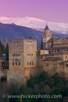 The Alhambra, a fabulous example of a Moorish citadel and palace, with the Sierra Nevada mountains in the background. This view can be seen from the Mirador de San Nicolas in Albayzin, City of Granada, Andalusia, Spain.