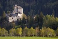 The ancient Reifenstein Castle surrounded by an evergreen forest near Vipiteno in the South Tyrol, Italy, Europe.