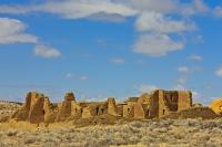 Crumbling stone walls mark the outer perimeter of Pueblo Bonito, ancient ruins found at the Chaco Culture National Historic Park in New Mexico, USA.