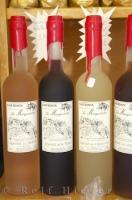 Bottles of aperitifs on display at a shop in Gourdon village in Provence, France in Europe.
