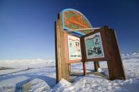 A magic place with a beautiful sign, the arctic circle crossing along the Dempster highway, photographed on a very cold winter day, Yukon, Canada.