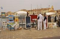 Artists set up their easels of their paintings along the waterfront of St Tropez as this is where a majority of the rich and famous disembark.
