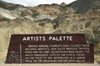 A sign explaining how the Artists Palette was formed in Death Valley National Park, California, USA.