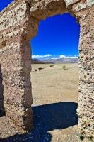 Looking through the doorway of the stone building ruins of the Ashford Mill in Death Valley National Park, California.
