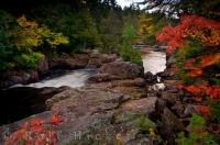 Autumn colors surround the banks of the Riviere du Diable in Parc National du Mont Tremblant in Laurentides, Quebec in Canada.