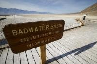 A sign showing that the Badwater Basin is 282 feet below sea level in Death Valley, California, USA.