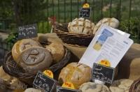 A bakers stall displays a fine selection of fresh bread, at the market in the village of Moustiers Ste Marie in the Alpes de Haute area of Provence, France.