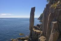 The Rock Balancing is a columnar basalt stack of rock which is perfectly balanced along the rocky coastline in Saint Marys Bay on Long Island, Nova Scotia, Canada and has defied gravity for thousands of years.