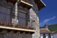 These windows brightened by pots of flowers on the balcony look over the friendly town of Hecho in the province of Huesca in Aragon, Spain.