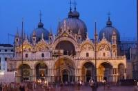 Stunningly lit by night lights, the Basilica San Marco is a superb example of 11th century architecture.