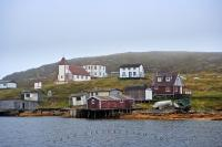 Encompassed by fog, the historic fishing village of Battle Harbour in Southern Labrador sits upon an island which is only reachable by water or air.