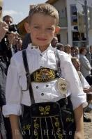 A young boy poses in his Lederhosen during the Bavarian Maibaum Festival in Putzbrunn, Germany.