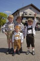 Children wore costumes of Lederhosen and suspenders during the Bavarian Maibaumfest in Putzbrunn, Germany.
