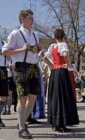 A man at a Bavarian festival is having a great time dancing around the Maibaum in Putzbrunn, Germany.