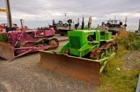 Beautiful colored bulldozers along the beach of Ngawi, New Zealand used to haul the boats out of the water.