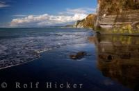 The North Taranaki Bight in Pukearue Historic Reserve is one of the many natural wonders of NZ where cliffs, beach and coastline make up the scenery.