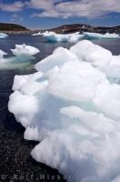 This large mass of pack ice has beached itself along the shores of St. Anthony Harbour on the Northern Peninsula of Newfoundland, Canada.