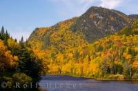 Deep in the heart of Parc de la Jacques-Cartier during fall, the hills and mountain slopes are carpeted in beautiful blazing scenery and colour alongside the Jacques-Cartier River in Quebec, Canada.
