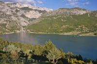 The beautiful Lac de Ste Croix is a man made lake capturing the flowing waters of the Verdon River in the Alpes de Haute in Provence, France.