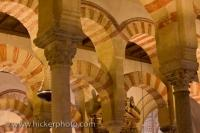A multitude of impressive, colorful arches highlight the beautiful Mezquita de Cordoba, an 8th Century mosque that is now used as a cathedral, located in Cordoba, Andalusia, Spain.