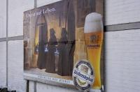 A large billboard advertising Weihenstephan beer with a slogan saying Thirsty for Life in Freising, Bavaria in Germany makes for a great picture.
