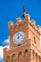 The Bell and Clock Tower of the Palazza Pubblico, the town hall, stands above Piazza Pio II, the main square in the historic old town centre in Pienza, which is a UNESCO World Heritage Site in Siena, in Tuscany, Italy.