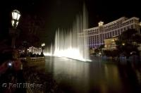 Streams of water shoot up into the sky during the show in front of the Bellagio Hotel and Casino in Las Vegas, Nevada.