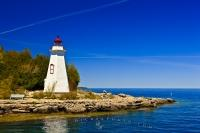 The first The Big Tub Lighthouse marks the entrance to the Big Tub Harbour near Tobermory on Lake Huron, Ontario, Canada.