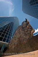 The high rise towers and detailed bison sculpture can be seen from down below looking towards the sky in the Frederick W Hill Mall in Regina, Saskatchewan - an open air pedestrian mall in the centre of the city.