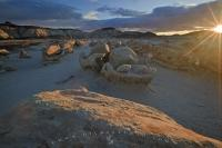 The sun rises at the Cracked Egg formations in the Bisti/De-Na-Zin Wilderness area of New Mexico, USA.