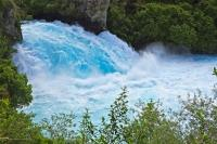 A waterfall with a unique blue coloring to it is Huka Falls, located near Taupo on the North Island of New Zealand.