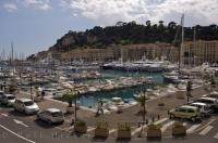 Along the Cote d'Azur in Nice, Provence in France there is a beautiful boat marina which lines the waterfront with the Parc du Chateau adorning the backdrop.