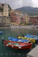 A colourful line up of small fishing boats in the Vernazza Harbour, Liguria, Italy.