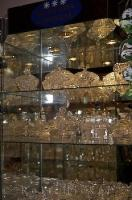 Glass shelves are lined with Bohemia Crystal at one of the shops along the lane that leads up to the Karlstein Castle in the Czech Republic.