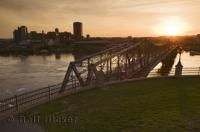 This bridge is the Pont Alexandra which crosses the Ottawa River at Nepean Point in Ottawa, Canada.