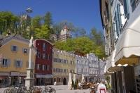 Colourful buildings and cafes line the streets of Bruneck in South Tirol, Italy, Europe.