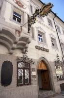 Picturesque building and sign in the town of Brunico, South Tyrol in Italy, Europe.
